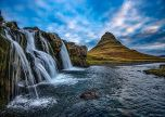 Blue sky cascading waterfall in iceland