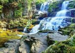 Waterfall cascading against the rocks