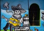 Relaxing playing guitar street art