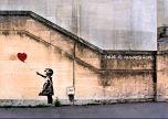 Banksy girl letting go of heart